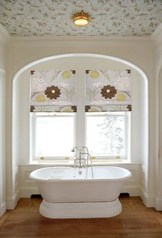 roman shades, hard wood floors, and wallpaper on the ceiling. love