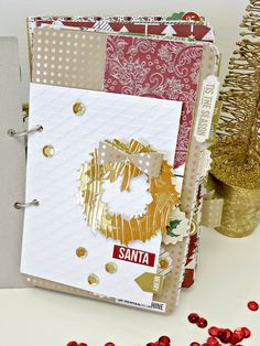 Tinsel & Company papers- die cut gold mirror paper wreath- Sizzix Tim Holtz die... TC Craftwell machine and embossing folders.