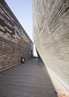 Concrete and local brick with local curlture impression and can be great contrast with glass-NingBo History Museum
