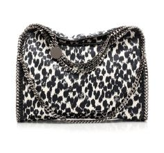 New version of the medium Falabella by Stella McCartney. In this version the fabric is printed in black and white animalier, which matching with the classic chain, makes it even more precious. @Stella McCartney