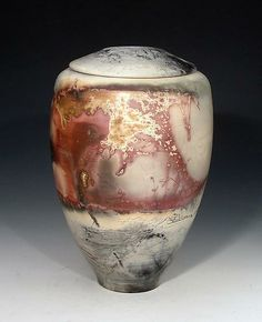 """This wheel thrown #earthenware urn is burnished to a the smoothness of a river stone with fine terra sigillata slip. Each piece is nested with metals, sawdust, mineral soaked straw and salt marsh hay for a final firing in a gas saggar kiln. """"Large Spirit Keeper."""""""