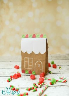 Turn a brown paper lunch bag into a cute little gingerbread house. Perfect for giving delicious homemade gifts to friends, neighbors, teachers, and more.
