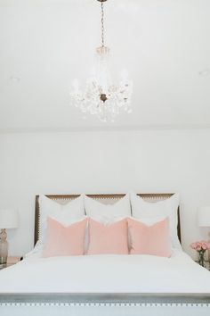 Such a gorgeous, romantic bedroom! Click through for more on how I built the perfect bedroom that's just the right amount of girly :)