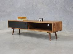Why place your TV on the wall when you can incorporate this retro entertainment unit into your home?
