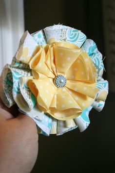 Fabric Flower Tutorial - use fabric circles (approx 6 large and 6 small); secure with hot glue gun (or could use needle and thread)