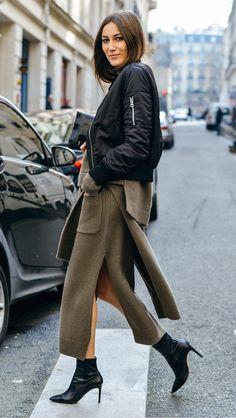 Olive green slit skirt, black jacket, pointed-toe boots
