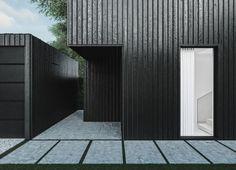 Bardage bois noir brillant