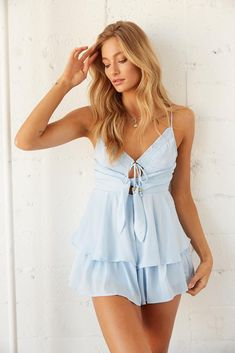 Hey dream girl! The Sienna Ruffle Tie Romper is the perfect piece for any occasion. This flirty number features a smocked v neckline met by a keyhole cut out with a beaded front tie detail, and tiered ruffle shorts for a flouncy silhouette. Available in light blue. Slip on the Alaia Crocodile Slide Sandal for a chic final touch! Sorority Recruitment Dresses, Sorority Outfits, Sorority Rush, Sexy Dresses, Casual Dresses, Fashion Dresses, Summer Dresses, Women's Fashion, Rush Outfits