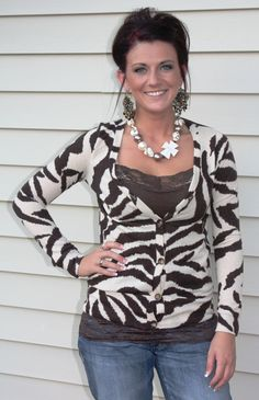 zebra..anyone in double digits should NOT be wearing zebra! eww. is that a badge on her neck?!? double eww