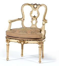 Italian Arm Chair, 19th century, painted Classical armchair with giltwood roping along the crestrail, scrolled arm terminals, needlework seat on stop-fluted legs.