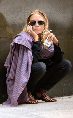 Boho gal Mary-Kate Olsen took a smoke break while flaunting classic aviator sunnies with her usual vintage garb.