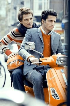 Orange outfits on an orange Vespa!