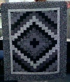 My 1st Quilt. The pattern is around the world, the colors were my choice.