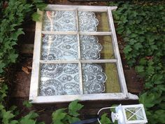 It works! Spray paint through lace onto the back of an old window - love it! By Sherie Tillman