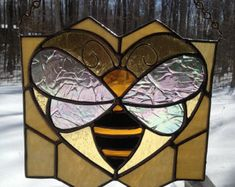 This is a very BIG stained glass honey bee. For the beekeeper, or the lover of bees, this one will BZZZ all year long :) just watch out for the stinger!  The Item weighs 7.5 ounces  It is 10 Wide and 7 Tall  No patina is used, just polished silver solder lines.  Suction cup is included.  I ship via USPS Flat Rate Shipping. This will fit in a MEDIUM box. I include insurance and tracking with my shipping cost.  Thank you for looking