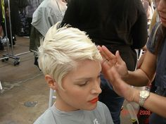 LOVE this color and cut! Perfect ice platinum color with thick wavy hair in an abstract pixie cut......