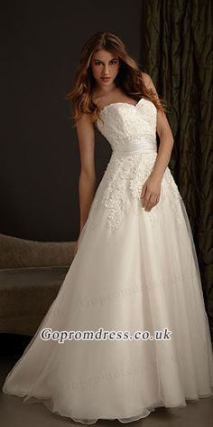 lace wedding dress. with straps or a lace insert over the shoulders