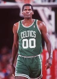 Robert Parish. number 00 for the Boston Celtics. He won four NBA Championships 1981 1984 1986 1997. He was a 7 ft aand 235 lbs dominating anyone in the post. HE was a dunker and a rebounder that wanted everyball.