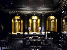 Black Gold Room Beaufort Bar, Savoy Hotel, London - The Beaufort Bar exudes theatrical glamour. In an Art Deco interior of jet-black and burnished gold décor, the bar is all about champagne, cocktails and cabaret. It offers one of London's most exte… Lounge Design, Bar Lounge, Design Hotel, Chair Design, Art Deco Hotel, Hotel Decor, Dark Interiors, Colorful Interiors, Interior House Colors