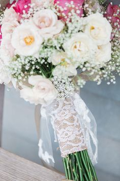 Vintage inspired wedding bouquet wrapped in lace and burlap.