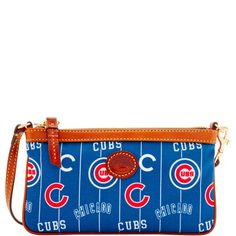 Team pride is in full swing on our MLB Nylon Collection. The epitome of understated chic, this wristlet is the perfect all-in-one for your mobile phone and your cash and cards. It features a zip closure and a wrist strap.