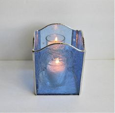 In the winter, here, just after the sun sets behind the mountains, if there is snow on the ground, everything turns blue. Its my favorite time of day. Its as if peace settles over the world. I tried to capture that in this candle holder. The back panel is a mirror etched with