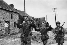 June 16, 1944: American soldiers capturing German prisoners, Saint Sauveur le Vicomte//Robert Capa