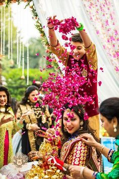 flower shower on Indian bride with her brother| Indian Wedding Photography Ideas| Brother Sister love | The ultimate guide for the Indian Bride to plan her dream wedding. Witty Vows shares things no one tells brides, covers real weddings, ideas, inspirations, design trends and the right vendors, candid photographers etc.| #bridsmaids #inspiration #IndianWedding | Curated by #WittyVows - Things no one tells Brides | www.wittyvows.com