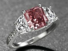 A RARE COLOURED DIAMOND RING. Set with a fancy red rectangular-cut diamond, weighing approximately carat, flanked on either side with half-moon diamond, to the pavé-set diamond shoulders and platinum hoop Pink Diamond Jewelry, Colored Diamond Rings, Colored Diamonds, Rare Diamonds, Pink Diamonds, Colored Engagement Rings, Thing 1, Fantasy Jewelry, Diamond Are A Girls Best Friend