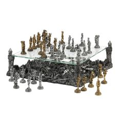 Battleground Chess Set from Koehlerhomedecor.com - Prepare for battle and defend your kingdom with this intricate and breathtaking medieval-inspired chess set! The glass game board is held aloft by four towers of the castle, revealing the remains of previous clashes below. Buy wholesale at Koehler Home Décor.