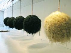 'excentricidad eliplica (ecliptic eccentricity)' (2000) by artist Jane Castillo. synthetic hair balls, 3 x 3 x 3 ft. via artist a day