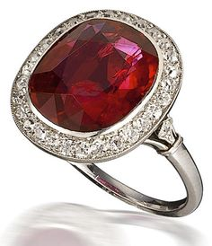 An art deco ruby and diamond ring, Mauboussin, 1924. Centering an oval-shaped ruby within an old European-cut diamond surround; with maker's mark, no. 81844; ruby weighing approximately 4.75 carats; mounted in platinum; size 5 3/4.