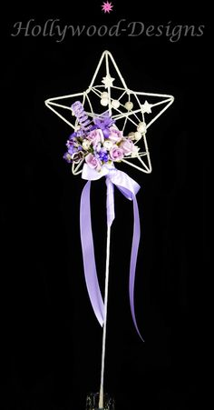 Purple Fairy Wand - This is the perfect accessory for a bridesmaid or flower girl, something that looks beautiful and sparkly but also a perfect way to keep the girls entertained on your wedding day! This Silver Star wand has been delicately with purple ribbon, Swarovski crystals & a beautiful array of roses. Perfect for little flower girls and bridesmaids to carry down the aisle as a statement piece. Approximately 13cm in size at its widest point. The stem is approximately 30cm long. Flower Girl Wand, Flower Girls, Purple Ribbon, Purple Roses, Brooch Bouquets, Bridal Bouquets, Bridesmaid Flowers, Bridesmaids, Floral Wedding