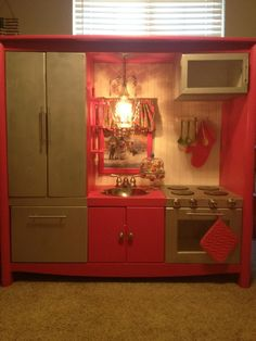 Old entertainment center... play kitchen