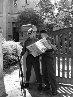 Haycock and A. Whittle, members of the Canadian Army Occupation Force stationed in Westerstede, Germany, read news of the surrender of Japan on 16 August Canadian Soldiers, Canadian Army, Canadian History, British Army, Ww2 Reenactment, Remember The Fallen, Army Infantry, Read News, World History