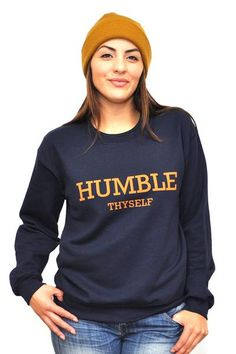 Inspired by James 4:10 Humble yourselves before the Lord, and he will exalt you. This is a a Navy Blue Unisex Sweatshirt that has a front/back design. The text color is orange. This is a MENS Sweatshi