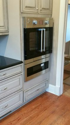 If you find it tough to get things in and out of built-in wall ovens, ditch the stool and go for something like this. A BlueStar French door oven mounted seamlessly above a Dacor microwave drawer. Installed by Grand's professional in-house install team.