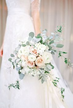 Brides: Rose Bouquet with Eucalyptus and Jasmine. Jasmine and leafy eucalyptus freshen up this classic blush and white rose bouquet by Fleurs De France.