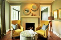 Relaxing Transitional Library by Jamie Beckwith.  Repeat the Reflection  One framed mirror over the mantle might have worked just fine. Adding a second mirror, and angling the placement, provides a nice air of informality to this welcoming library space and acts as a nice counterpoint to the simplicity and symmetry of the fireplace surround.