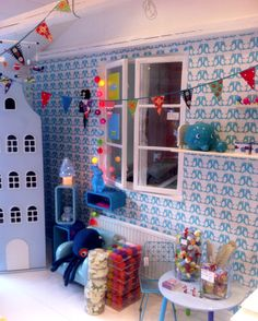 Charming shop in Sweden with Isak penguin wallpaper.