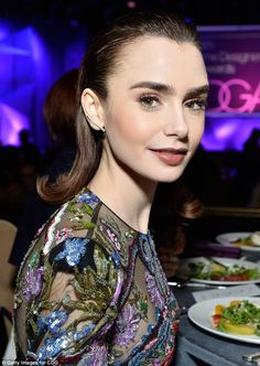 Toast of the town: Lily Collins, 27, was the belle of the ball at the annual Costume Designers Guild Awards in Beverly Hills on Tuesday night