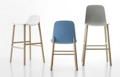 The high stool entirely replicates the seat of the chair and becomes a comfortable bar stool, whereas the low stool has a different seat, shortened for a more harmonious overall effect.