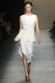 His dresses were pretty and sexy—right where most women want to be. Peplum gave shape to a white dress, while a smattering of stones fell across a white slipdress and a tunic worn over leather trousers. And he even offered a black leather pseudo slipdress. Just because he could make it light and elegant and not even remotely goth.   - HarpersBAZAAR.com