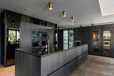 Poliform Artex in grey stained oak, integrated appliances from Gaggenau and Miele, tabletop in composite stone. Grey Stain, Bespoke Kitchens, Tabletop, Kitchen Design, Appliances, Stone, Home Decor, Gadgets, Gray Stain