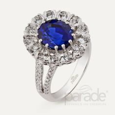 Flower design engagement ring with large sapphire...Know more @ http://www.diamondjewellerycollection.com/2014/03/sapphire-engagement-ring-collection-from-parade.html
