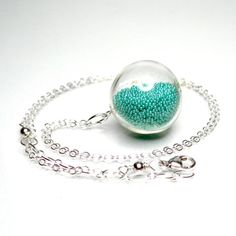 Teal color microbeads in clear hand blown glass by thestudio8, $26.00