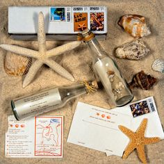 message in a glass bottle wedding invitation, opal metallic paper, real sand + shells in bottle, rafia tie, custom stamps, digital printing