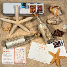 message in a glass bottle wedding invitation, opal metallic paper, real sand + shells in bottle, rafia tie, custom stamps, digital printing