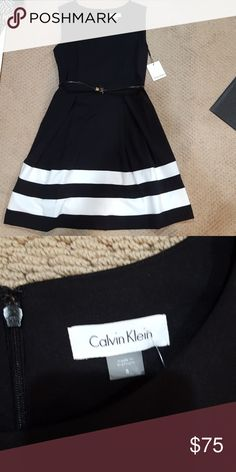 😍 Calvin Klein dress Black dress with white stripes at the bottom by Calvin Klein. Comes with a cute belt around the waist. Would be perfect for the office! NWT. Never worn. Calvin Klein Dresses Midi