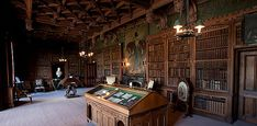 The library at Abbotsford, consisting of over 7,000 volumes, remains as it was when Sir Walter Scott arranged the books on the shelves.
